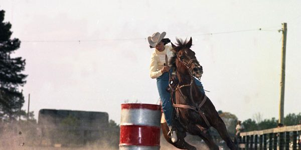 Photo of Woman barrel racing. Item from the Horse Country USA Archive.